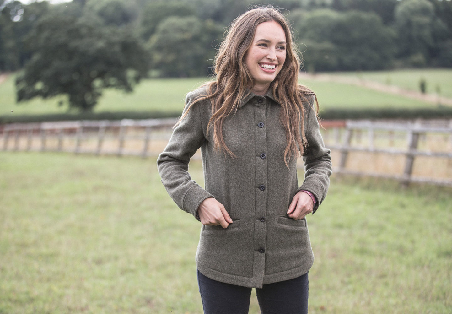 woman smiling wearing a Herne jacket